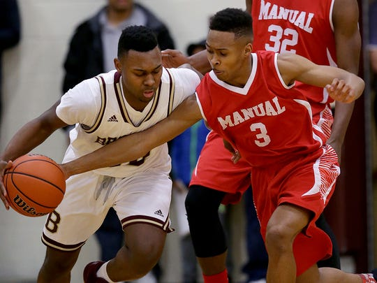 Brebeuf Jesuit's Kobie McNeal (left) drives against Manual's Nathan Meriwether, March 1, 2017.