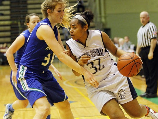 Gates Chili's Diona Johnson, right, drives inside against