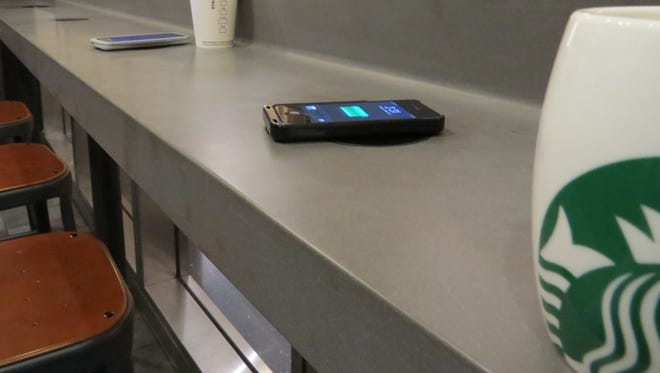 Duracell Powermat phone recharging stations in action at Starbucks.