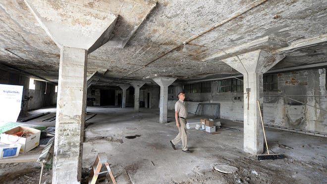 NeighborWorks project manager Tim Denissen inspects the interior of the armory building on Chicago Street that is under consideration for an urban farming operation Tuesday.
