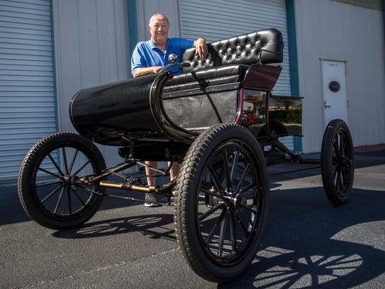 Richard DeSchane stands with his restored 1903 Oldsmobile