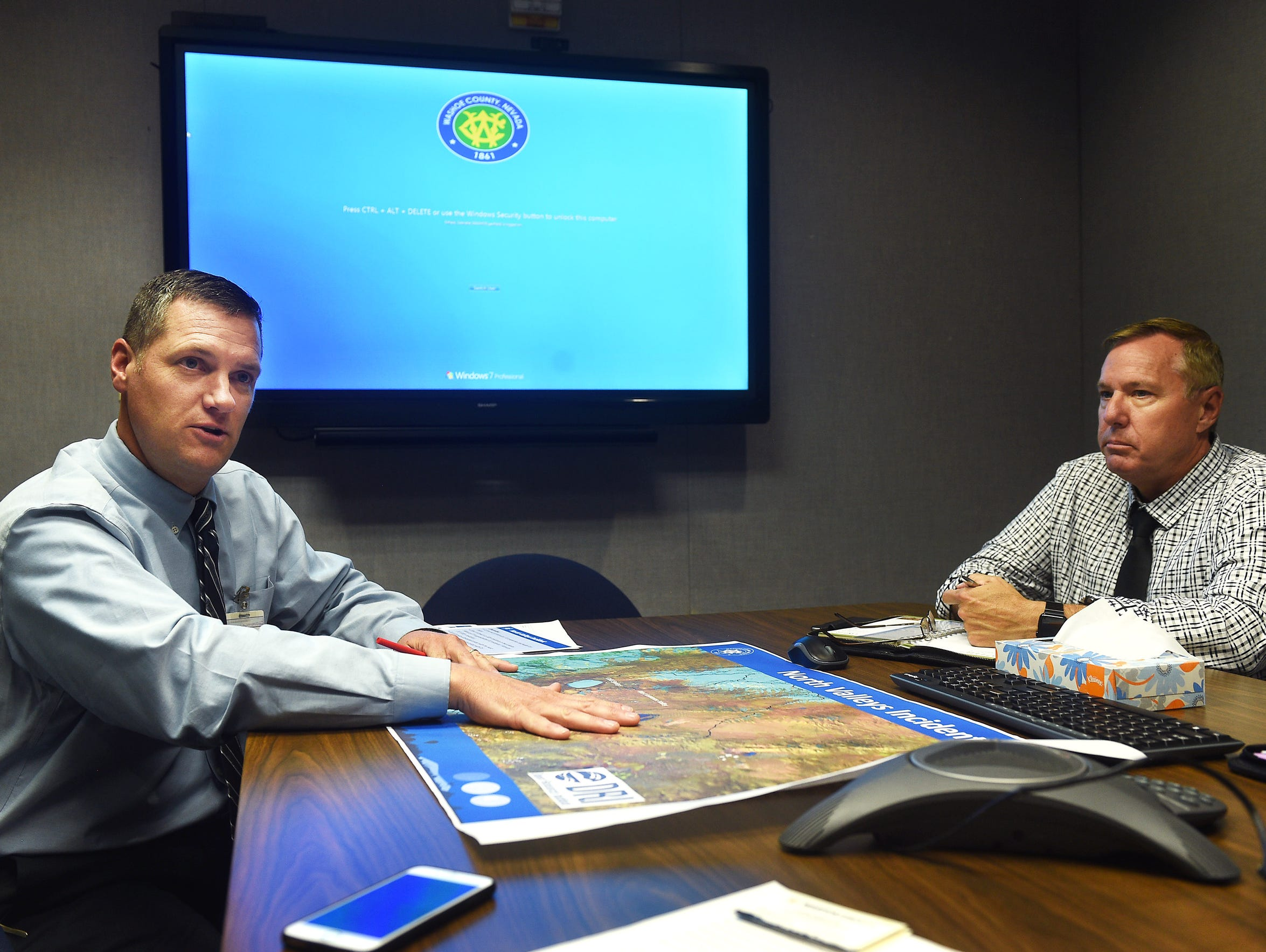 Washoe County Assistant Manager Dave Solaro, left,