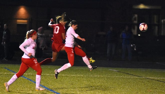 Morgan Jackson (10) takes to the air to score a goal for Indian Hill, Nov. 7, 2017.