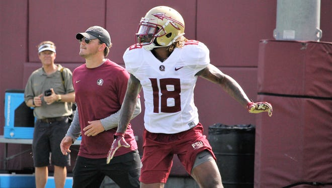 FSU WR Warren Thompson runs a route during practice on Aug. 9, 2018.