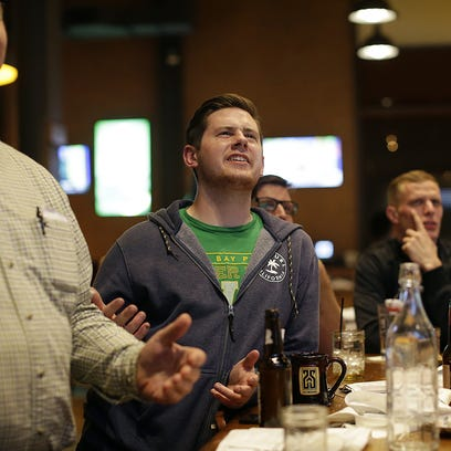 People watch the NFL draft Thursday night at 1919 Kitchen & Tap at Lambeau Field.