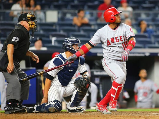 Angels first baseman Luis Valbuena watches solo home