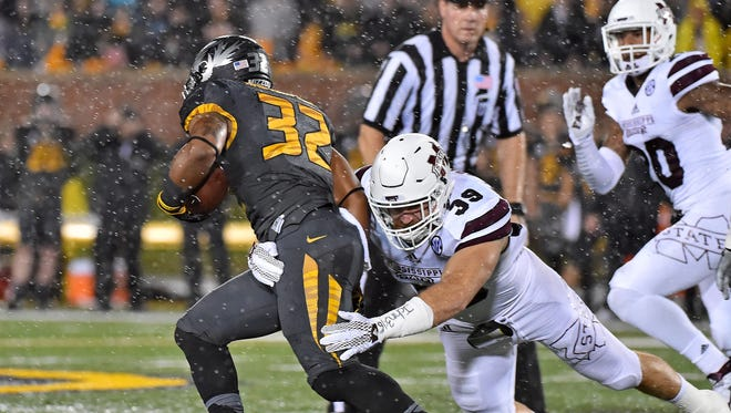 Mississippi State linebacker Richie Brown (39) tackles Missouri Tigers running back Russell Hansbrough (32) during the first half at Faurot Field. Mandatory Credit: Jasen Vinlove-USA TODAY Sports