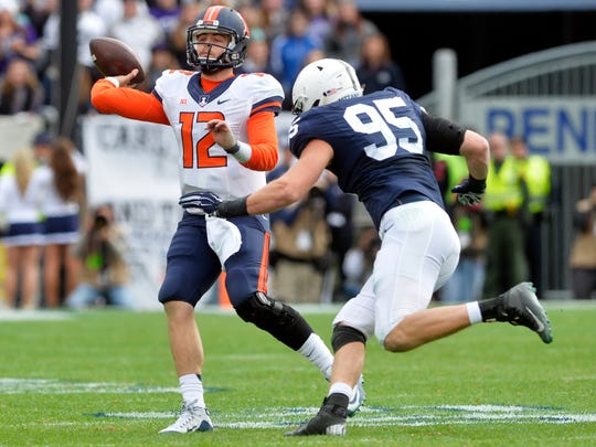 Illinois Fighting Illini quarterback Wes Lunt (12) throws the ball out of bounds under pressure from Penn State Nittany Lions defensive end Carl Nassib (95) in the first half of an NCAA Division I football game Saturday, Oct. 31, 2015, at Beaver Stadium. Penn State swept Illinois 39-0.