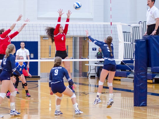 St. Clair's Brenna Johnson (4) jumps to block a hit