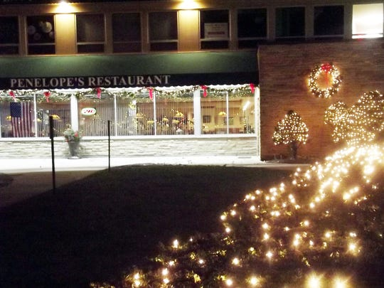 Penelope's Restaurant in downtown Elm Grove is one of the businesses that participate in lighting up the holidays with a display.