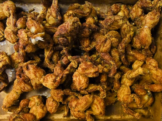 Adventurous foodies devoured frog legs, gator tail, and more Thursday, Jan. 18, 2018, during the first day of the Fellsmere Frog Leg Festival. The festival continues Friday from 4 - 11 p.m., Saturday from 10 a.m. - 11 p.m., and Sunday from 11 a.m. to 6 p.m.
