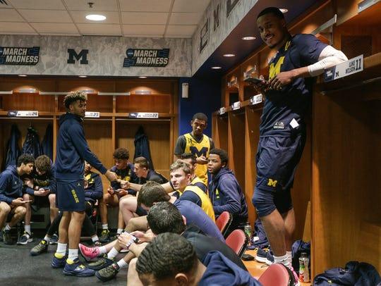 Michigan players include guard Muhammad-Ali Abdur-Rahkman,