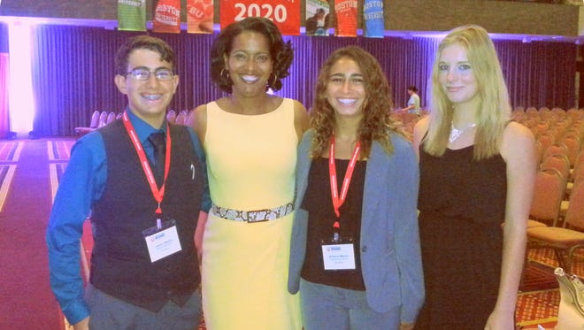 Deming students meet with the 2016 National Teacher of the Year Jahana Hayes after her keynote address at the conference. From left are Justyn Martin, Hayes, Britanie Martin and Jessica Medicus.