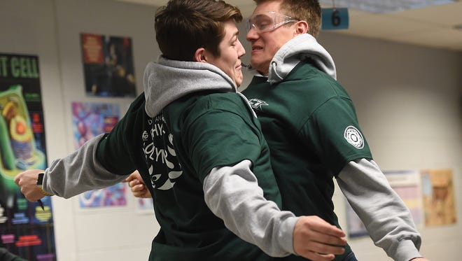 Teammates Jack Marks, left, and Regis Maher chest bump and celebrate during the Physics Olympics held at Dallastown High School. The two seniors were participating in the Hit the Wall challenge, using velocity and gravity to predict where a ball would hit against a wall from a certain distance of firing.