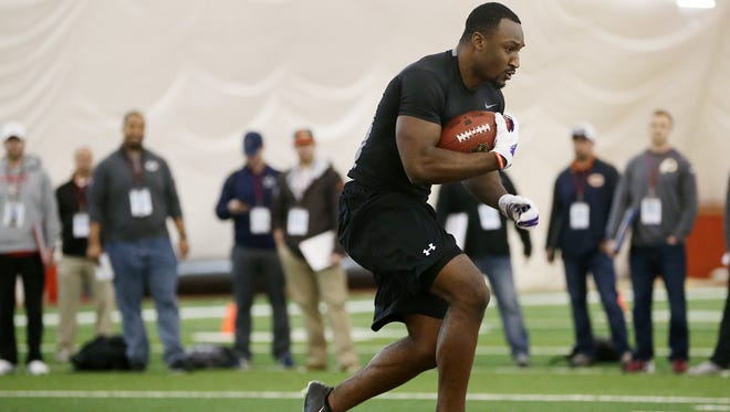Running back Savon Huggins, a former top high school recruit, works out for NFL scouts at Rutgers Pro Day.