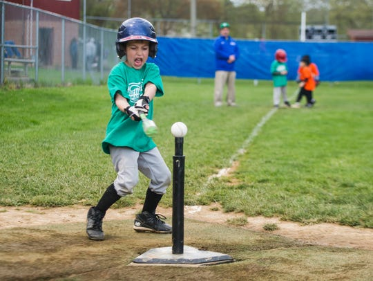 Maxwell Johnson, 6, takes a mighty swing during his