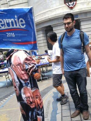 Sean Philip Cotter interviews a man in Bernie Sanders pajamas July 27, 2016, in Philadelphia. John A. Pavoncello - jpavoncello@yorkdispatch.com