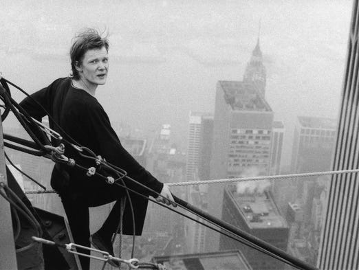 French tightrope walker Philippe Petit, 24, looks back at a photographer as he rests before his second walk across a cable stretched between New York's World Trade Center towers on Aug. 7, 1974.