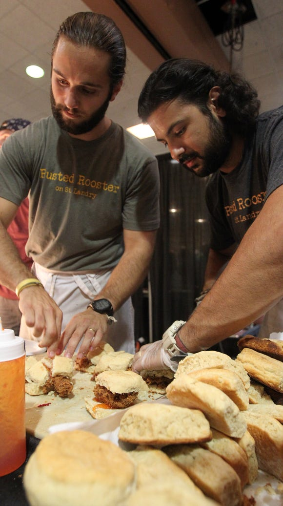 Rusted Rooster employees prepare buttermilk biscuit,