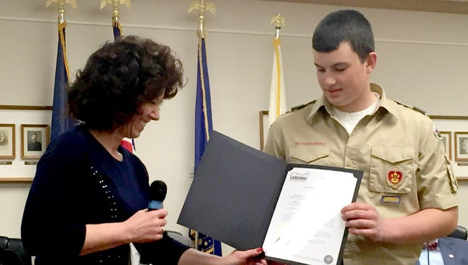Lebanon Mayor Sherry Capello presents a certificate of recognition recently to Drew Speraw, a member of Boy Scout Troop 412, who organized a community service project involving about 20 volunteers who cleaned, painted and stenciled stormwater boxes on Ninth and 10th streets.