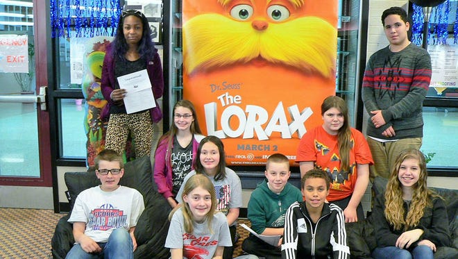 Cedar Crest Middle School students participated in the annual Read Across America poetry contest during March. These students were awarded a first, second or third place in the contest: top standing, from left, Kyreanna Barrett and Darius Garcia; kneeling from left, Avery Atkins and Samantha Etzweiler; middle from left, Isabella Cruz and Patrick Beyer; front, from left Ryan Hickernell, Lauren Witmeyer, Micah Zeisloft and Mackenzie Mease. The theme was 'Platform for Change.' Since this is an election year, students explored the social/political issues to which Dr. Seuss hints throughout some of his books. A poetry contest capped the week's activities. The topic was 'How Would You Make America Better?' Read Across America activities across the district are sponsored by the Cornwall-Lebanon School District Education Association.
