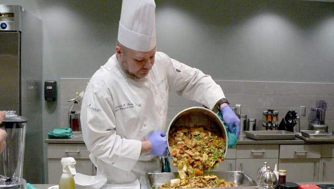 Lancaster General Health Executive Chef Ed Long serves his healthy version of chicken pot pie at the one of the facility's recent cooking demonstrations. The facility, at 1701 Cornwall Road, North Cornwall Township, has hosted almost 200 county residents at healthy cooking demonstration events this year. The latest lineup of healthy spring seminars will include Chef Leslie Turner Bures of Artful Events Fine Catering, who will show participants how to easily prepare salmon in a healthy, flavorful manner, but, with a twist. This event is slated for 6:30-7:30 p.m., Wednesday, May 18. Questions and samplings are part of the evening's free event. Those interested are encouraged to register by visiting LGHealth.org/Lebanon or calling 1-888-LGH-INFO (544-4636).