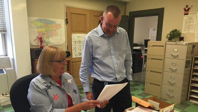 Jo-Ellen Sohn, deputy clerk for the Lebanon County Voter Registration Office, shows new director Michael Anderson a list of third party statewide candidates who have qualified for the November election.