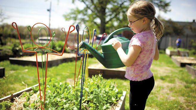 Encourage children's fascination with the natural world by inviting them into the garden.