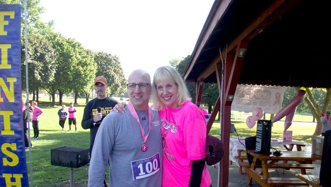 Michelle Remlinger, organizer of the Lebanon County Cops for a Cure 5-K Run and 1-Mile Fun Walk, poses with Lebanon police Chief Todd Breiner, who came in first in his age group at the event, which was held Oct. 15 at South Hills Park in South Lebanon Township. More than 250 people participated in fundraiser, which raised more than $5,000 for the Lebanon YMCA Pink Complete Program for Breast Cancer Survivors.