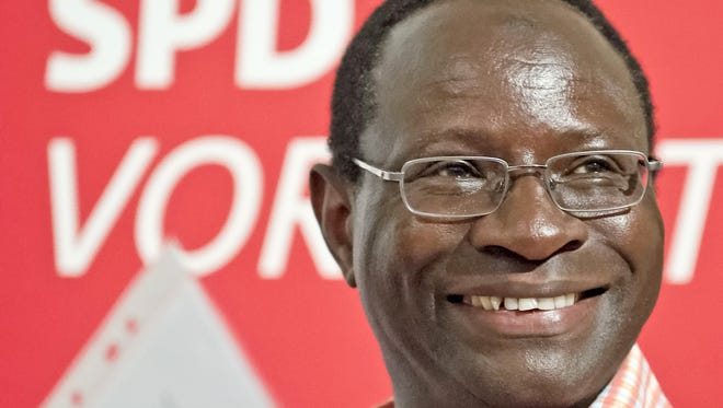 Karamba Diaby, a German Social Democratic Party candidate,  smiles during an election campaign in Halle, Germany, on July 25, 2013.