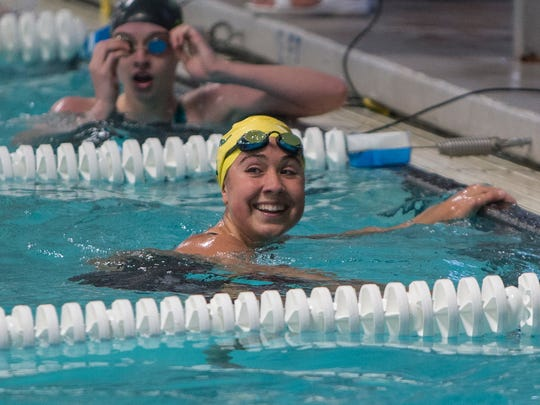 Manogue's Donna Depolo smiles after winning the girls 4A 100 yard breaststroke race during the State Swimming Meet in Carson City on Saturday.