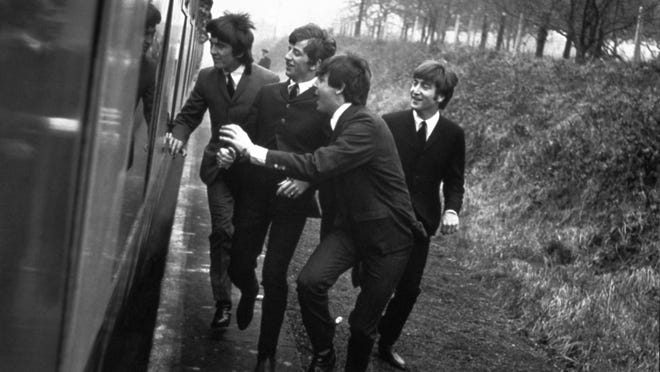 "George, Ringo, Paul, and John in ""A Hard Day's Night."""