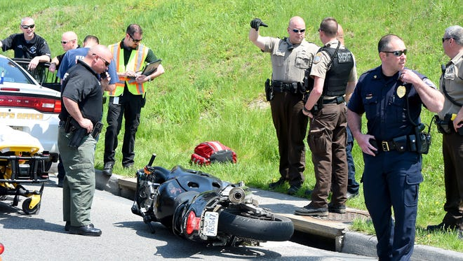 First responders remain on the scene of a single vehicle wreck involving a motorcycle at Greenville Avenue and Statler Boulevard on Tuesday, April 21, 2015. Wanted on outstanding warrants, Richard Knight used the motorcycle in an attempt to elude law enforcement in a chase that began in the Buffalo Gap area and ended in Staunton. Knight lost control of the bike while going through the intersection.