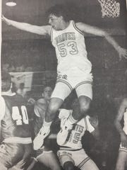 Union County High School forward Terry Marsh leaps in an attempt to block a shot from Owensboro Catholic's Brad Brown during a January 1991 game.