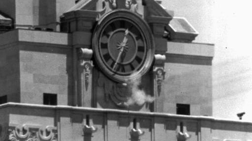 In this Aug. 1, 1966, file photo, smoke rises from the sniper's gun as he fired from the tower of the University of Texas administration building in Austin, Texas, on crowds below. Police identified the slayer as Charles Whitman, a student at the university. The new documentary 'Tower' about the shooting spree captures a sense of terror and confusion that was unprecedented then as it has become chillingly commonplace today.