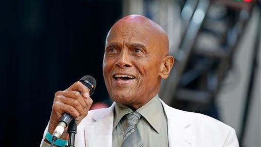 Singer and activist Harry Belafonte speaks during a memorial tribute concert for folk icon and civil rights activist Pete Seeger at Lincoln Center's Damrosch Park in New York. Belafonte and Maureen O'Hara are among those will be honored by the motion picture academy's board of governors. The academy said Thursday, that Belafonte will receive the Jean Hersholt Humanitarian Award at the academy's sixth annual Governors Awards on Nov. 8 in Los Angeles.