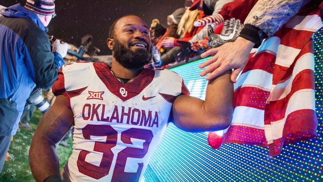 Samaje Perine and Oklahoma celebrated their eighth Big 12 win in eight tries on Nov. 19.