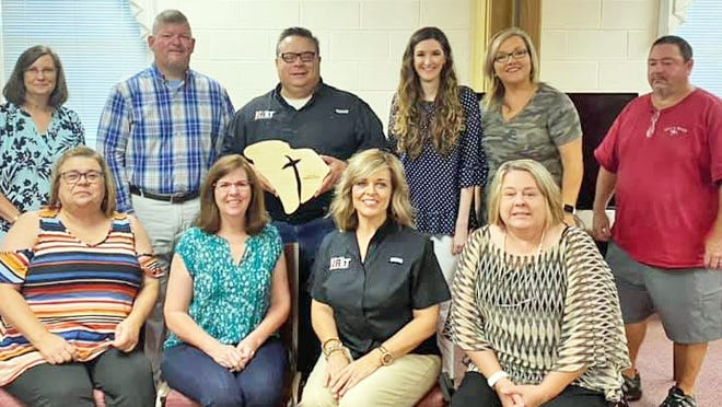 Barnwell First Baptist Church's staff accepted an award from the S.C. Baptist Convention for the number of baptisms in 2019. Pictured left to right: (front row) Kelly Johnson, Tori Peay, Dana Bell, and Diana Zorn; (back row) K Epperson, Jeremy Creech, Rev. Bart Kelley, Sarah Wooldridge, Tori Towne, and Phil Hair. Not pictured is Michael Pisacreta.