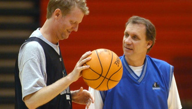 """Minnesota Timberwolves head coach Flip Saunders, right, talks with Craig Kilborn, left, then host of """"The Late Late Show with Craig Kilborn,"""" at the team's training camp at St. John's in 2003. Saunders, who died Sunday, and his team held training camp at both St. Cloud State and St. John's over his time as head coach."""