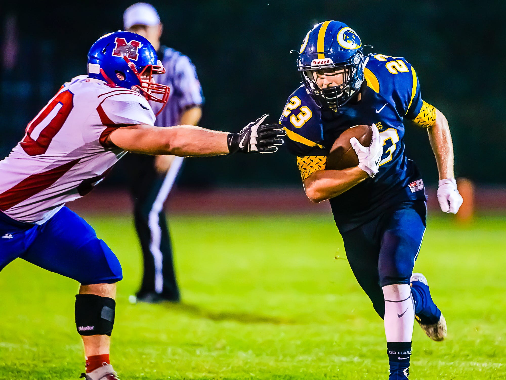 JD Ross runs past a Mason defender to the Mason 23 yard line for a first down late in the second quarter of a game Friday in DeWitt.