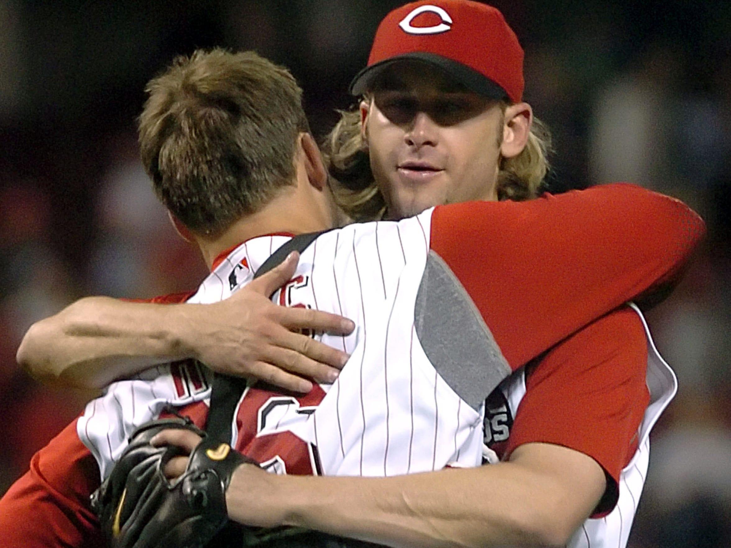 Cincinnati Reds' pitcher Bronson Arroyo, right, hugs
