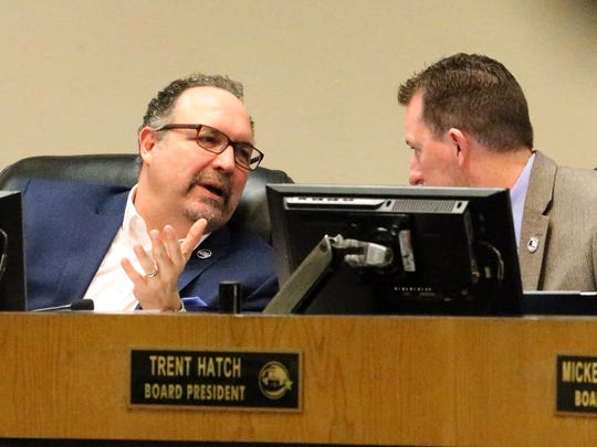 El Paso Independent School District Superintendent Juan Cabrera, left, talks with board of trustees President Trent Hatch at a board meeting in February.