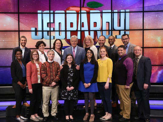 Beth Binder, a sixth-grade teacher at Ridgeview Classical Schools, poses with Jeopardy host Alex Trebek and other teacher contestants. Binder is competing in the Jeopardy Teacher's Tournament May 7-18, 2018.