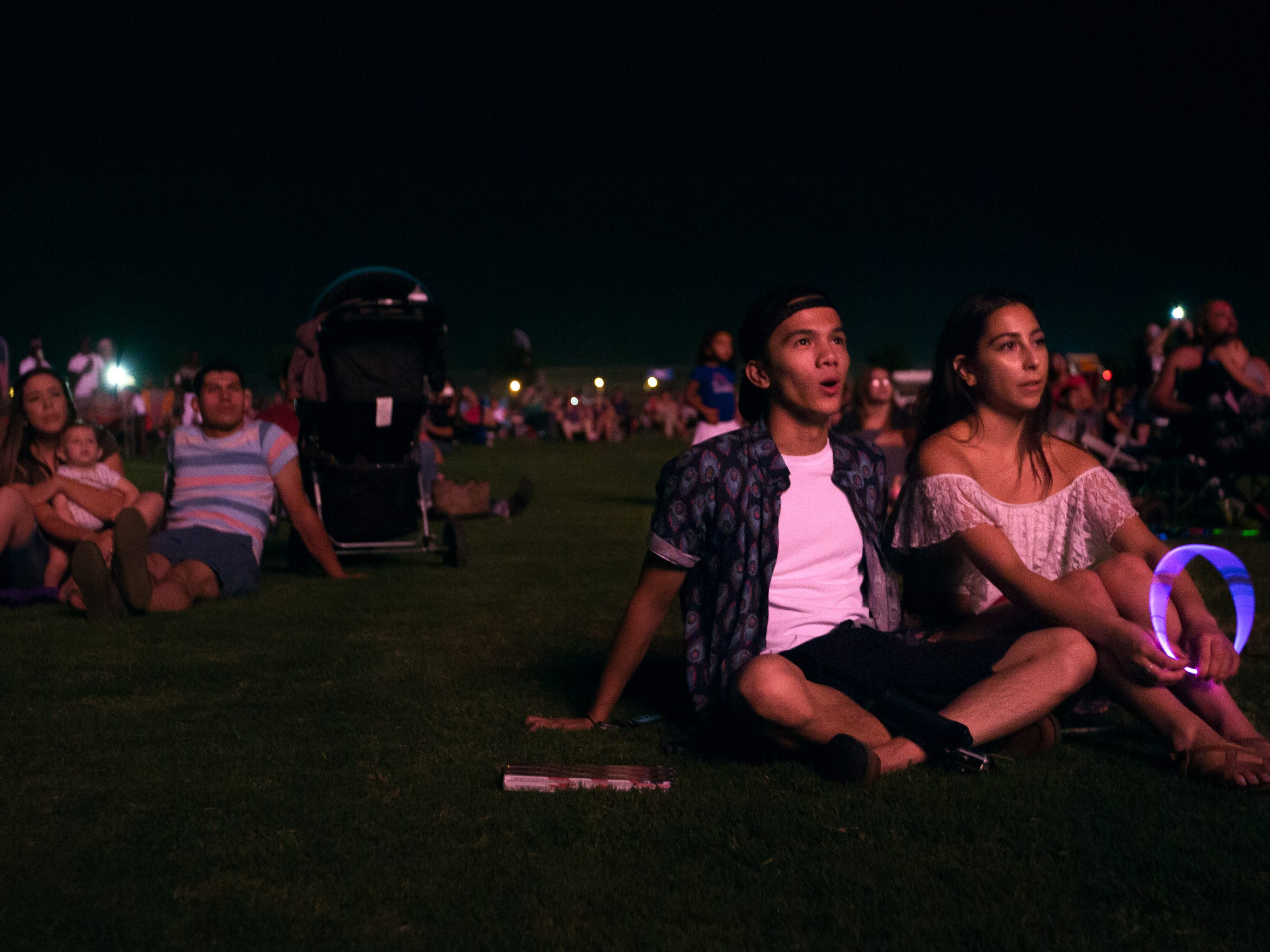 Ian Navarro, right, and Sabrina Flores watch fireworks go off at the Field of Dreams during the 2016 Fourth of July celebration.