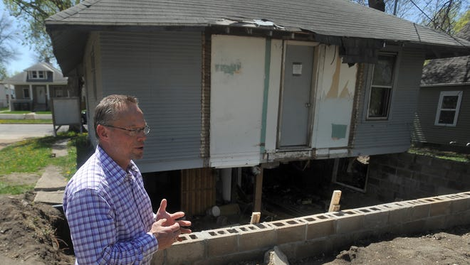 Wayne Wagner, housing development director with Affordable Housing Solutions, talks about the dilapidated home at 1420 E. Third St. in the Whittier neighborhood.