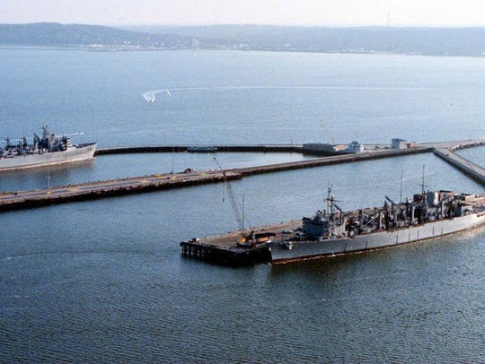 Two ships are moored in Middletown, N.J., at the pier of Naval Weapons Station Earle on Nov. 29, 2000. A new Defense Department report says the military installation was damaged by storm surge and intense rain from Hurricane Sandy.