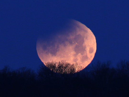 The lunar eclipse of the super moon in the sky over