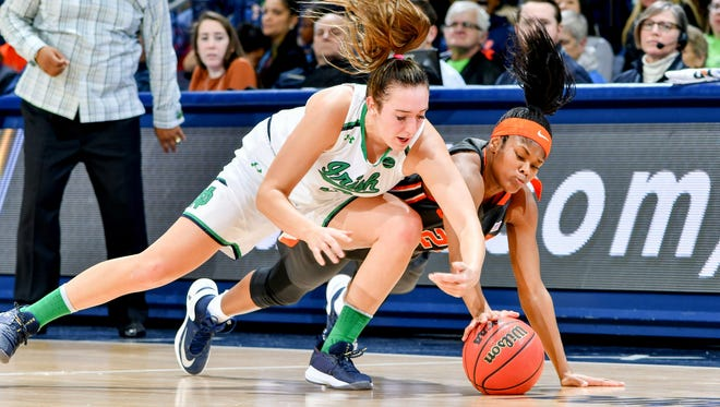 Notre Dame Fighting Irish guard Marina Mabrey (3) and Syracuse Orange guard Isis Young (23) fight for possession in the first half at the Purcell Pavilion.