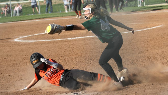 Madison's Julia Litt attempts to tag out a Mt. Vernon player  during a home game on Tuesday evening.
