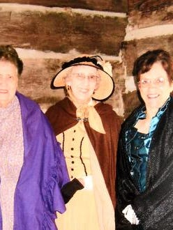 Merle Thompson (from left) Maralou Spear and Wanda Davenport sport Civil War-era attire at the Baxter County History Day at Rapp's Barren Settlement in Cooper Park. They are shown at the George Washington Jones House, which was constructed around 1868. The house was donated to Baxter County Historical & Genealogical Society by Dr. Ray and Edie Stahl.
